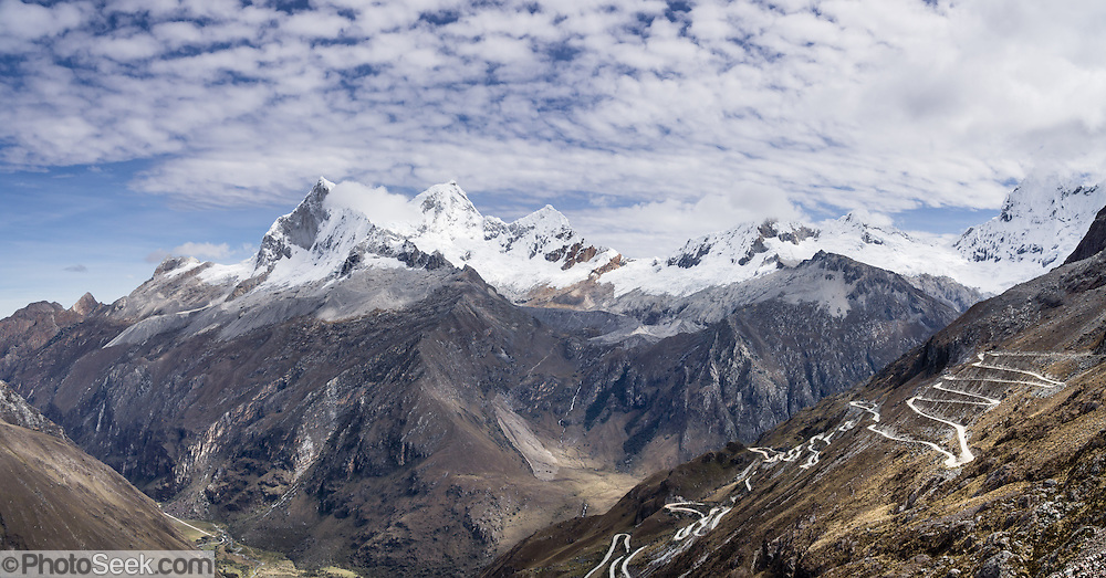 Nevado Huandoy (20,866 feet or 6360 meters elevation) rises high above Llanganuco Valley and the switchbacked road to Portachuelo Pass, in Huascaran National Park (UNESCO World Heritage Site), Cordillera Blanca, Andes Mountains, Peru, South America. This panorama was stitched from 2 overlapping photos.