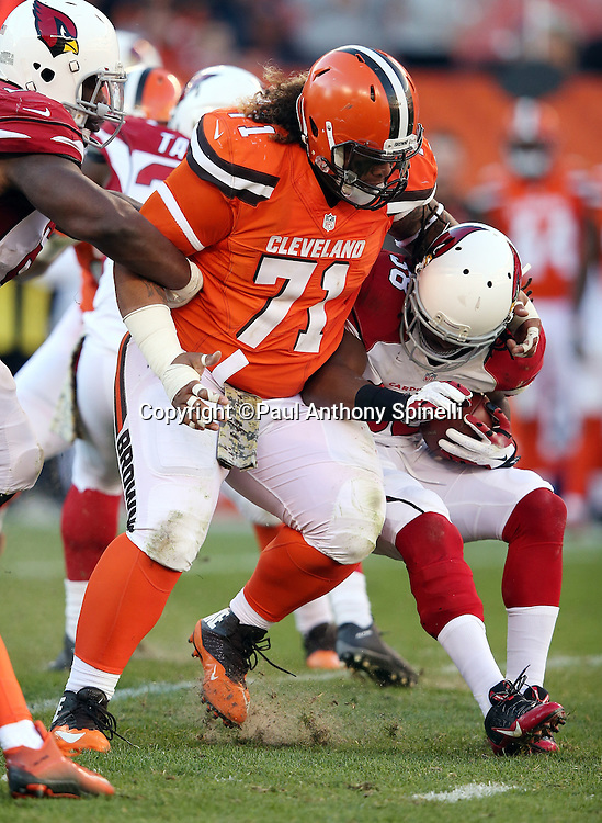 Cleveland Browns nose tackle Danny Shelton (71) tackles Arizona Cardinals running back Andre Ellington (38) on a fourth quarter run during the 2015 week 8 regular season NFL football game against the Arizona Cardinals on Sunday, Nov. 1, 2015 in Cleveland. The Cardinals won the game 34-20. (©Paul Anthony Spinelli)