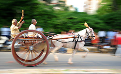 July 31, 2017 - Allahabad, Uttar Pradesh, India - Allahabad: People take part in horse cart racing Gehre Bazi on the streets of Sangam City. The traditional sport is organized every year on every Monday of Sawan Month. (Credit Image: © Prabhat Kumar Verma via ZUMA Wire)