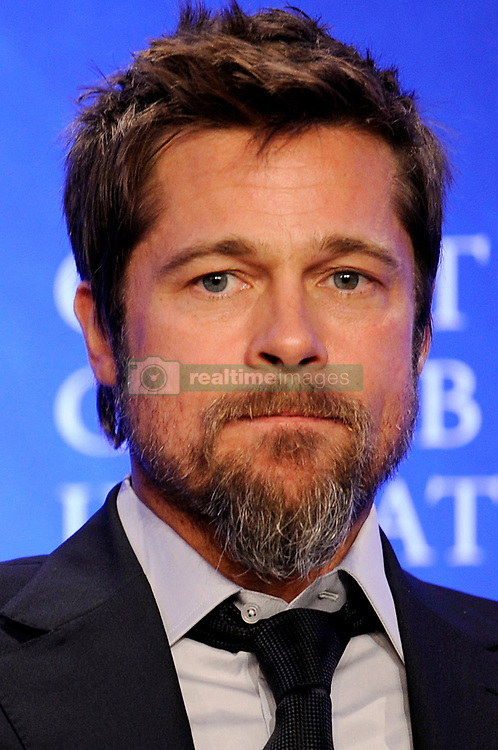 Actor Brad Pitt attends the Clinton Global Initiative (CGI) September 24, 2009 in New York. Photo by Mehdi Taamallah/ABACAPRESS.COM (Pictured:Brad Pitt)  Clinton Global Initiative Pitt Brad Barbe Bouc Barbiche Beard Engagement Seule Seul Seuls Seules Alone New York City New York USA United States of America Vereinigte Staaten von Amerika Etats-Unis Etats Unis Headshot Portraits Portrait Headshots Head Shot Head Shots    202993_067 New York City Unitd