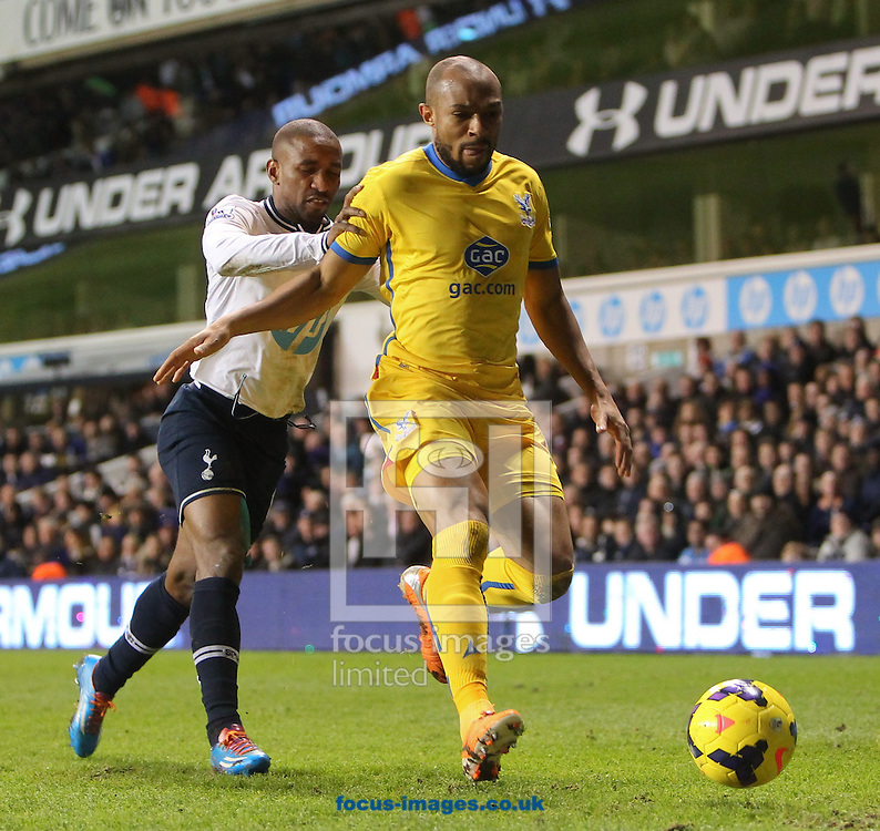 Picture by John Rainford/Focus Images Ltd +44 7506 538356<br /> 11/01/2014<br /> Jermaine Defoe of Tottenham Hotspur gives Jason Puncheon of Crystal Palace a push in the back during the Barclays Premier League match at White Hart Lane, London.
