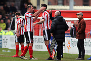 Lincoln City forward Matt Rhead (9) is substituted by Lincoln City forward Ollie Palmer (8) during the EFL Sky Bet League 2 match between Lincoln City and Exeter City at Sincil Bank, Lincoln, United Kingdom on 30 March 2018. Picture by Mick Atkins.