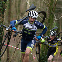 Brian Nevin from Burren Racing Team running up the hill at Ennis CX Cyclocross Race at Lees Rd, Ennis