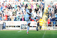 Swansea city's Wayne Routledge celebrates by kicking a tv microphone after he scores his sides 2nd goal. Barclays Premier league, Swansea city v Reading at the Liberty Stadium in Swansea, South Wales on Saturday 6th October 2012.   pic by  Andrew Orchard, Andrew Orchard sports photography,
