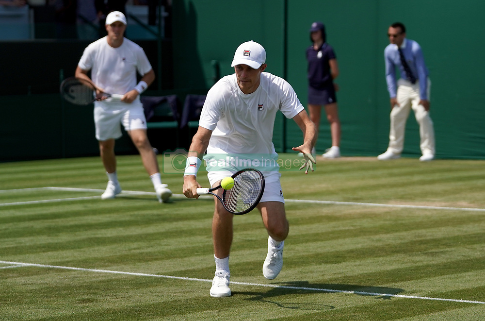 Neal Skupski and Ken Skupski in action in their doubles match on day five of the Wimbledon Championships at the All England Lawn Tennis and Croquet Club, Wimbledon.