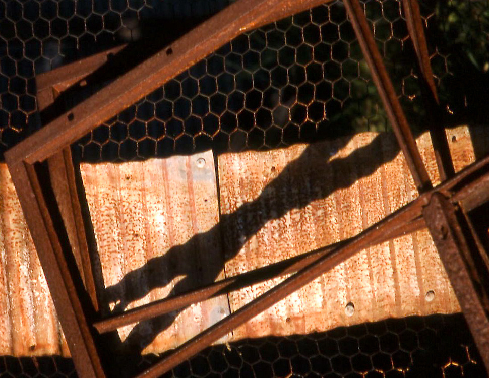 Discarded metal windows and other building material create an abstract assemblage.