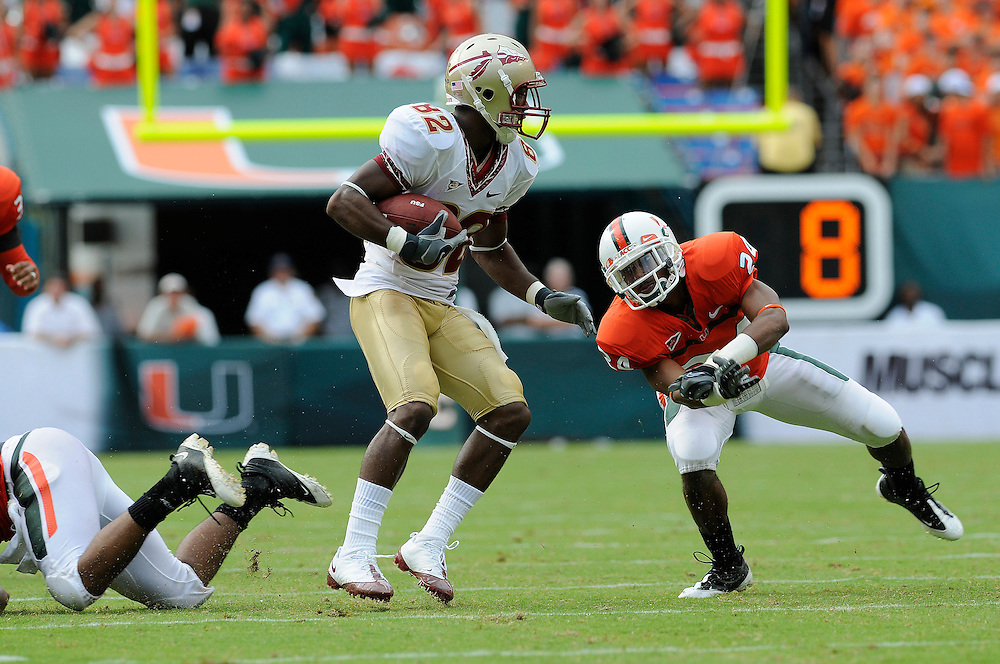 October 4, 2008 - Miami Gardens, FL<br /> <br /> University of Miami defensive back Chavez Grant attempts to tackle Florida State University wide receiver Taiwan Easterling during the Seminoles 41-39 victory over the Hurricanes at Dolphin Stadium in Miami Gardens, Florida.<br /> <br /> JC Ridley/CSM