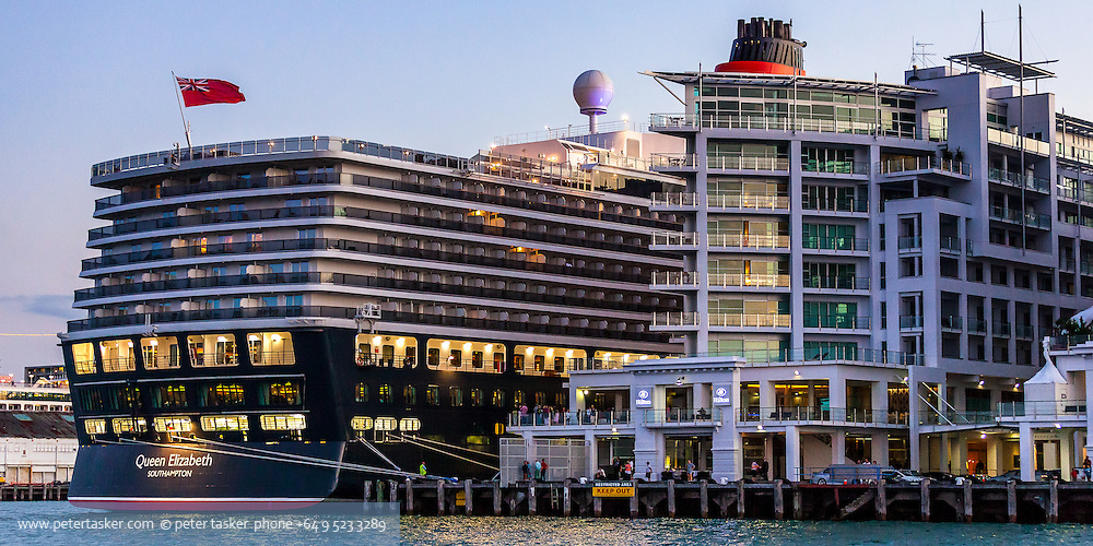 Cruise liner, Queen Elizabeth, along side the Hilton Hotel, Auckland, New Zealand.