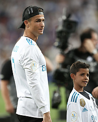 August 17, 2017 - Madrid, Spain - Cristiano Ronaldo (L) of Real Madrid enters the pitch with his son Cristiano JR. (R) during the celebrations for winning the Spanish Super Cup in the return match against Barcelona at Santiago Bernabeu Stadium in Madrid, Spain on August 17, 2017. Cristiano Ronaldo received five-match ban after being booked with a red card in the previous match. (Credit Image: © Raddad Jebarah/NurPhoto via ZUMA Press)