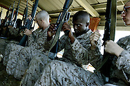 Recruit Coor and his fellow second phase recruits go over their M16A2 rifles in preparation to head out to the rifle range.  Marine Corps Recruit Depot at Parris Island in South Carolina is where all male recruits living east of the Mississippi River and all female recruits from all over the US receive their arduous thirteen week training in their quest to become marines. Even though there are two current active wars and a weak economy, recruitment has not been effected.  Actually, recruiting numbers have increased, with more young men and women looking toward the military for answers.