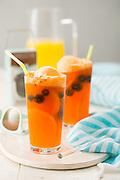 Frozen orange dream drinks with blueberries