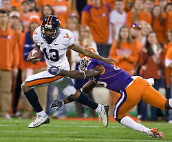 November 21, 2009; Clemson, SC, USA; Virginia Cavaliers cornerback Chase Minnifield (13) is tackled by Clemson Tigers cornerback Byron Maxwell (36) during the third quarter at Memorial Stadium.  Clemson defeated Virginia 34-21.
