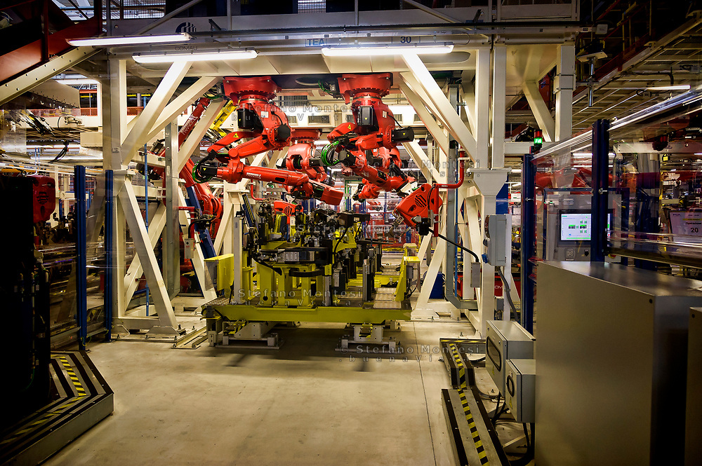 CASSINO, ITALY - NOVEMBER 24: A robot moves in the Body Shop where they assemble the Alfa Romeo Giulia and Stelvio in the Cassino Assembly Plant FCA Group. This is the most highly-automated area of the plant with nearly 1300 robots installed on  November 24, 2016. in Cassino, Italy.