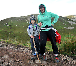 Early Climbers....Valeria Connolly with 8 year old son Cian from Collaney Co Sligo pictured on his way to the summit of Croagh Patrick yesterday.<br /> Pic Conor McKeown