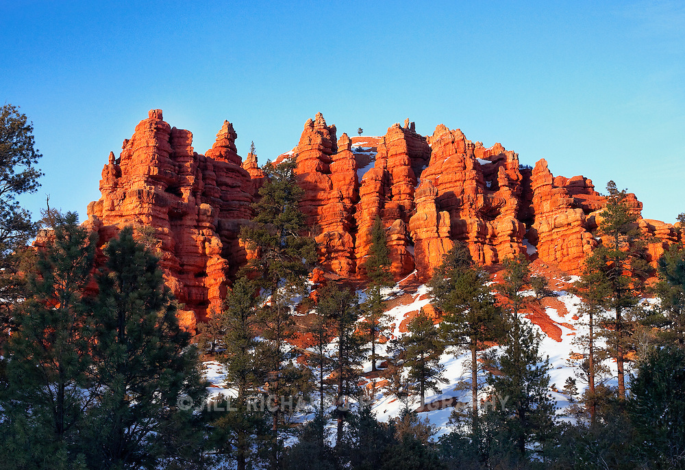 Often considered a summertime destination, Bryce Canyon National Park in southern Utah is even more breathtaking in winter, covered in snow. The red rocks in contrast with the white snow and blue skies, make this natural wonder a must-see for tourists traveling through southern Utah.