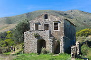 Tourists visiting Skordilis Mansion house ruin in oldest village of Corfu - ancient Old Perithia - Palea Perithea, Greece