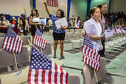 04 JULY 2012 - PHOENIX, AZ:  Soon to be new US citizens walk into the auditorium for the naturalization ceremony at South Mountain Community College in Phoenix Wednesday. About 250 people, from 62 countries, were naturalized as US citizens during the 24th Annual Fiesta of Independence naturization ceremony at South Mountain Community College in Phoenix Wednesday. The ceremony was presided over by the Honorable Roslyn O. Silver, Chief United States District Court Judge.   PHOTO BY JACK KURTZ
