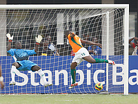 Photo: Steve Bond/Richard Lane Photography.<br />Ivory Coast v Benin. Africa Cup of Nations. 25/01/2008. Keeper Rachad Chitou dives as  Aruna Dindane heads for goal