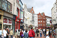 Shoppers on a busy Grafton Street Dublin Ireland