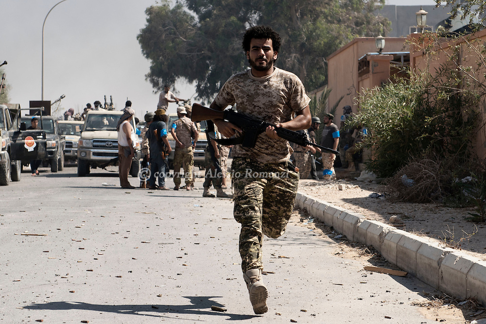 Libya, Sirte: a fighter sympathising with Libya's Government of National Accord's (GNA) runs to avoid ISIS sniper fire. Alessio Romenzi