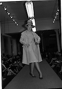 09/03/1964<br /> 03/09/1964<br /> 09 March 1964<br /> McBirney's Fashion show at McBirney's, Aston Quay, Dublin. Model Carol waring check dress, coat and hat from the collection.