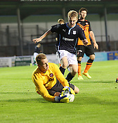 United keeper Mark McCallum saves from Dundee's Josh Skelly - - Dundee v Dundee United, SPFL Development League at Gayfield, Arbroath<br />