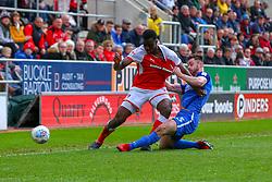 Andrew Hughes of Peterborough United pulls the shirt of Josh Emmanuel of Rotherham United - Mandatory by-line: Ryan Crockett/JMP - 30/03/2018 - FOOTBALL - Aesseal New York Stadium - Rotherham, England - Rotherham United v Peterborough United - Sky Bet League One