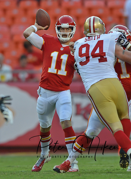 KANSAS CITY, MO - AUGUST 16:  Quarterback Alex Smith #11 of the Kansas City Chiefs drops back to pass against defensive tackle Justin Smith #94 of the San Francisco 49ers during the first half on August 16, 2013 at Arrowhead Stadium in Kansas City, Missouri.  (Photo by Peter G. Aiken/Getty Images) *** Local Caption *** Alex Smith;Justin Smith
