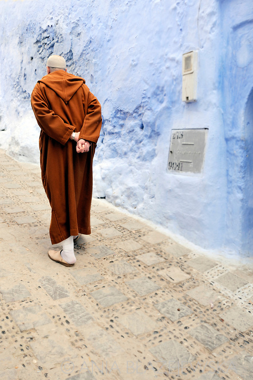 Morocco, Chefchaouen. Man walking the blue street of Chefchaouen.