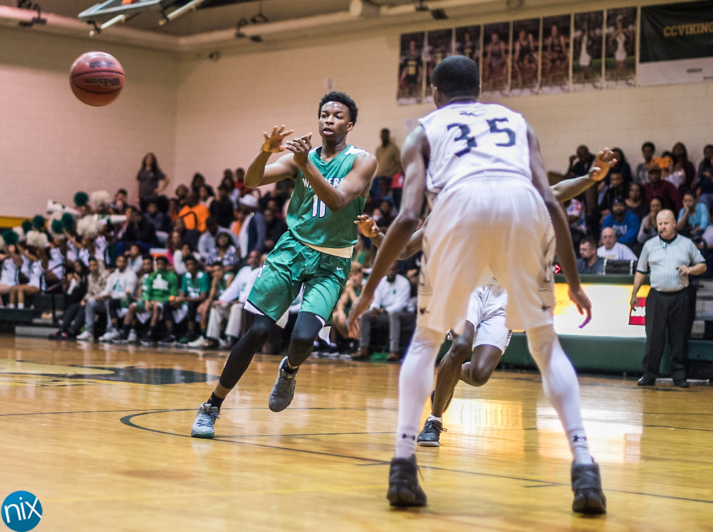 Kannapolis' T'Darien Neal (11) passes the ball against Concord during a South Piedmont Conference basketball game Saturday night at Central Cabarrus High School.