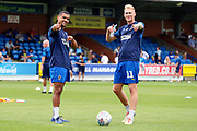 AFC Wimbledon midfielder Mitchell (Mitch) Pinnock (11) and AFC Wimbledon striker Kweshi Appiah (9) warming up during the EFL Sky Bet League 1 match between AFC Wimbledon and Rotherham United at the Cherry Red Records Stadium, Kingston, England on 3 August 2019.
