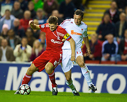 LIVERPOOL, ENGLAND - Wednesday, September 16, 2009: Liverpool's captain Steven Gerrard MBE is pulled down in the box by and Debreceni's Norbert Meszaros but no foul is given, during the UEFA Champions League Group E match at Anfield. (Photo by David Rawcliffe/Propaganda)