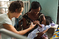 Harry Styles visits Philomnia's daughter Gwendoline 2 months old with pnuemonia in a Paediatric ward Princess Mary Louise Hospital, Accra, Ghana