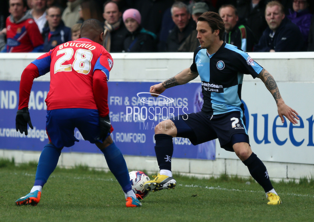 Sam Saunders taking on Andre Boucaud during the Sky Bet League 2 match between Dagenham and Redbridge and Wycombe Wanderers at the London Borough of Barking and Dagenham Stadium, London, England on 28 March 2015. Photo by Matthew Redman.