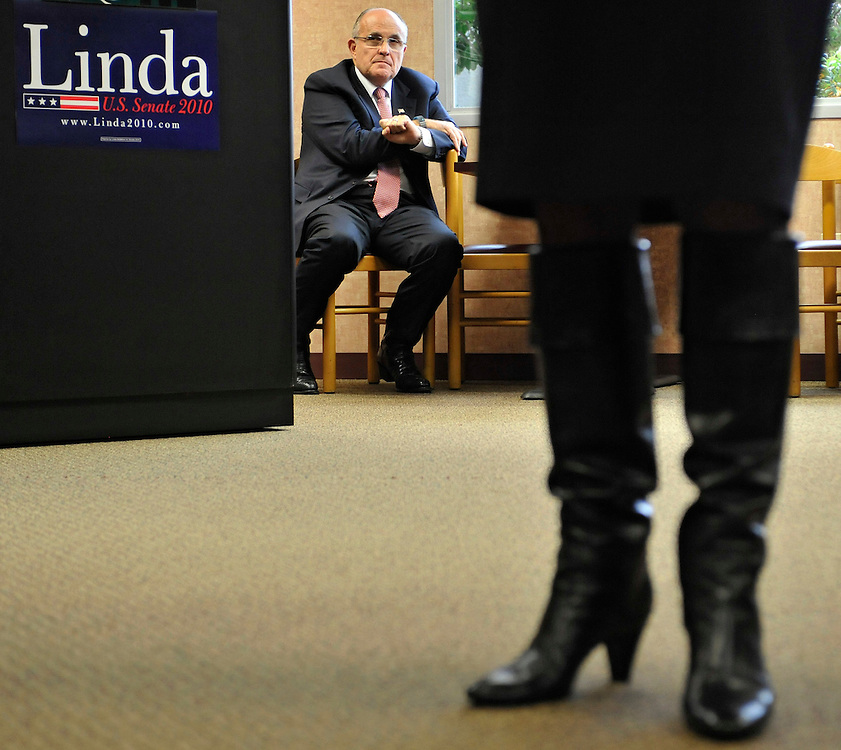 Former mayor of New York City Rudy Giuliani, center, listens to Republican U.S. Senate candidate Linda McMahon, right, during a campaign stop at SS&C Technologies Inc., a financial software services provider in Windsor, Conn. (AP Photo/Jessica Hill)