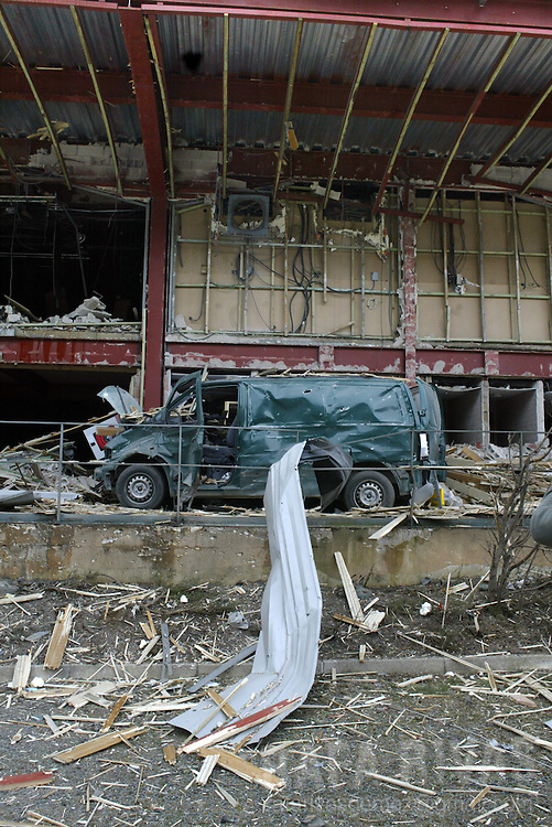 A destroyed van remains parked 15 February 2006 next to the disco, where a bomb exploded late 14 February in Urdax, in northern Spain, causing no injuries, following a warning in the name of the Basque separatist group ETA. PHOTO RAFA RIVAS