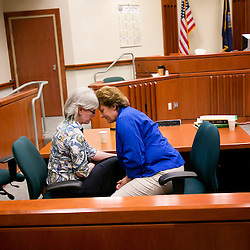 Married couple Rene Simpson (left) and Darcy Simpson (right) share a quite moment in Ada County Court while waiting for Judge McGregor Irby to enter the courtroom to begin their hearing allowing Darcey to legally adopt Rene's two sons, 15 year old Tray Simpson and 12 year old Dalton Simpson. Judge McGregor Irby, who turned down the adoption in September, was ordered to process it by Supreme Court in a February unanimous opinion.  Friday May 2, 2014