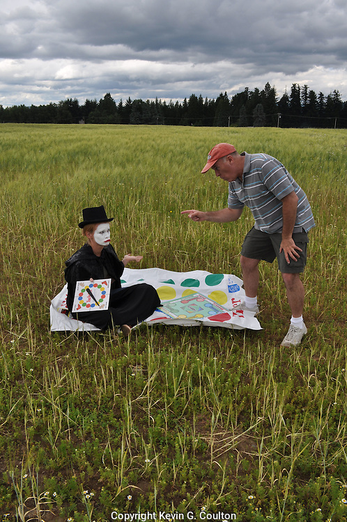 "Humorous photograph of a man and a mime in a field with the man not wanting to play games with the mime visually depicting the saying ""Mime (mind) games!"""
