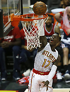 ATLANTA, GA - APRIL 28:  Guard Dennis Schroder #17 of the Atlanta Hawks dunks Game Six of the Eastern Conference Quarterfinals against the Washington Wizards at Philips Arena on April 28, 2017 in Atlanta, Georgia.  (Photo by Mike Zarrilli/Getty Images)