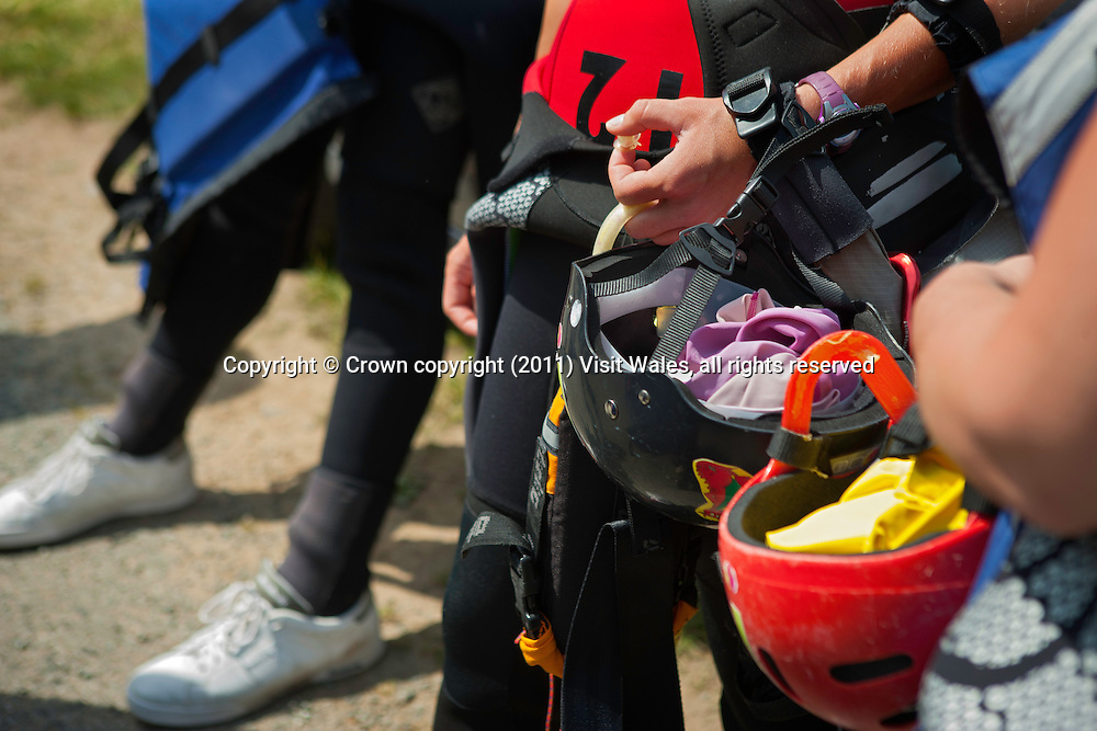 Group kitting up at minibus<br /> Coasteering<br /> North Pembrokeshireshire<br /> South<br /> Activities and Sports