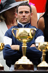 © Licensed to London News Pictures. 06/11/2012.  Winning jockey Brett Prebble riding Green Moon looks at the Melbourne Cup during the trophy presentation during the Emirates Melbourne Cup at the Flemington Racecourse, Melbourne. Photo credit : Asanka Brendon Ratnayake/LNP