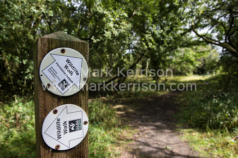 A signpost indicates two wildlife walks at Calvert Jubilee Nature Reserve on 27 July 2020 in Calvert, United Kingdom. On 22nd July, the Berks, Bucks and Oxon Wildlife Trust (BBOWT) reported that it had been informed of HS2's intention to take possession of part of Calvert Jubilee nature reserve, which is home to bittern, breeding tern and some of the UK's rarest butterflies, on 28th July to undertake unspecified clearance works in connection with the high-speed rail link.