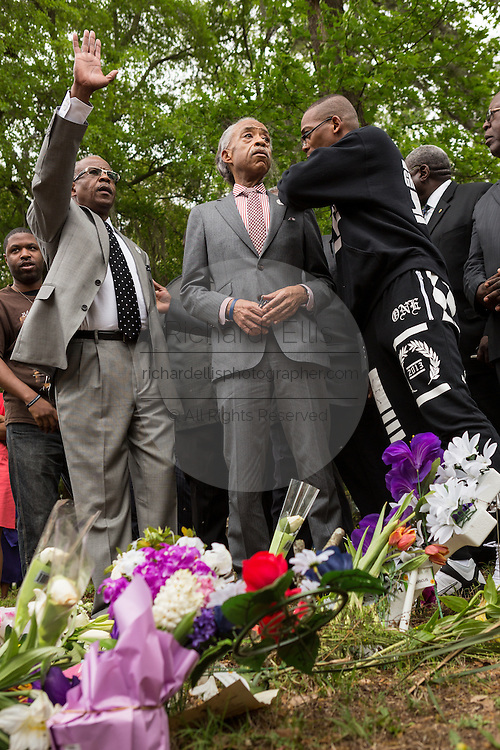 Rev. Al Sharpton speaks to an activist during a peace vigil at the spot where unarmed motorist Walter Scott was gunned down by police April 12, 2015 in North Charleston, South Carolina. About 100 people showed up for the brief vigil following a healing service at Charity Mission Baptist Church.