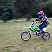 Boys on motor bikes