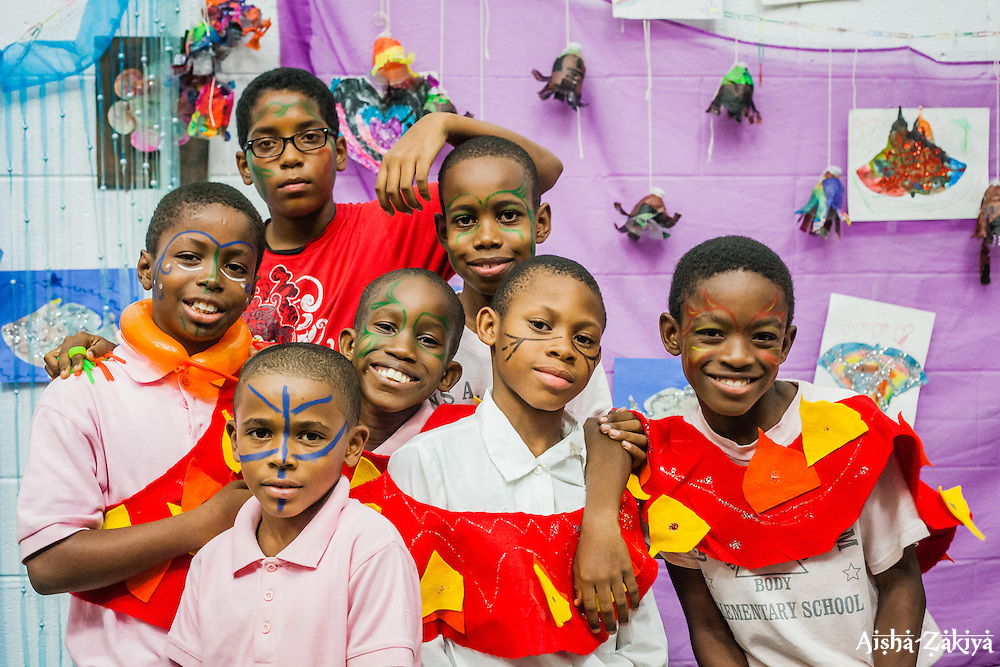 "Students at Gladys Abraham Elementary school perform ""A Blissful Quest for Unity"" written by art teacher Elise McCutcheon.  Students made their own costumes and set decorations with recycled materials.  Gladys Abraham Elementary school.  26 November 2013.  © Aisha-Zakiya Boyd"