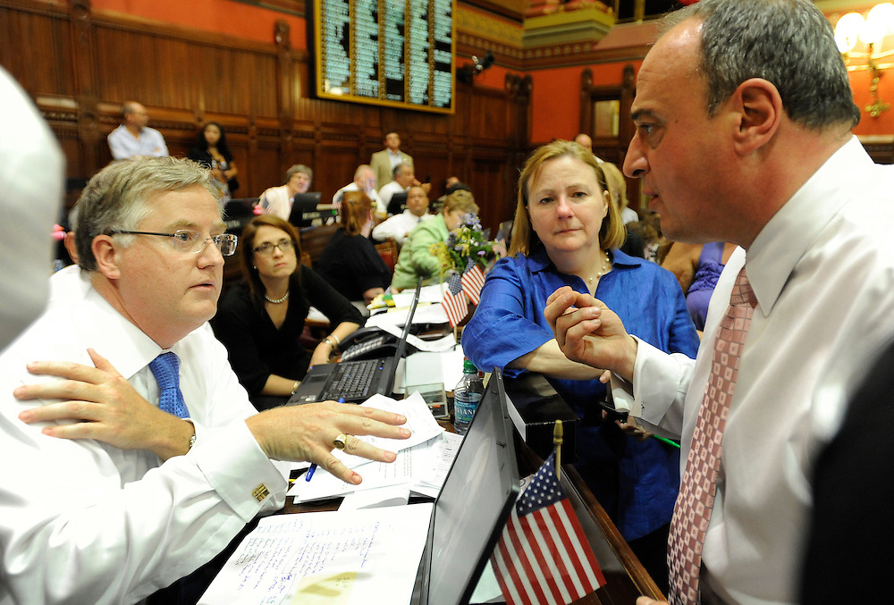 House Majority Leader Brendan Sharkey, D-Hamden, left, and House Minority Leader Larry Cafero, R-Nowalk, right, speak to one another in the final minutes of the last day session in House of Representatives at the Capitol in Hartford, Conn., Wednesday, June 8, 2011. (AP Photo/Jessica Hill)