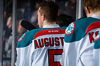 KELOWNA, CANADA - MARCH 13:  Cayde Augustine #5 of the Kelowna Rockets stands on the bench during the national anthem against the Spokane Chiefs on March 13, 2019 at Prospera Place in Kelowna, British Columbia, Canada.  (Photo by Marissa Baecker/Shoot the Breeze)