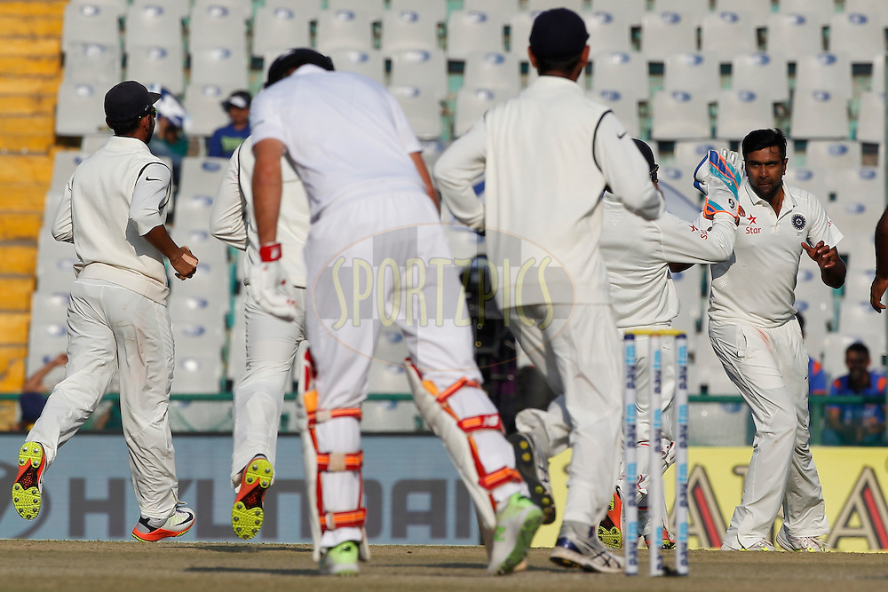 Ravichandran Ashwin of India celebrates the wicket of Alastair Cook Captain of England during day 3 of the third test match between India and England held at the Punjab Cricket Association IS Bindra Stadium, Mohali on the 28th November 2016.<br /> <br /> Photo by: Deepak Malik/ BCCI/ SPORTZPICS