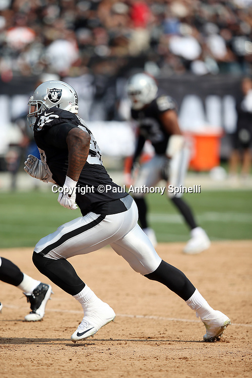 Oakland Raiders defensive end Aldon Smith (99) rushes the quarterback during the 2015 NFL week 1 regular season football game against the Cincinnati Bengals on Sunday, Sept. 13, 2015 in Oakland, Calif. The Bengals won the game 33-13. (©Paul Anthony Spinelli)