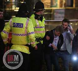 Manchester UK  24.12.2016: Images from Manchesters Gay Village during the Mad Friday celebrations this on the 23 and 24th of December,<br /> <br /> A Man is helped by police and friend to stand up